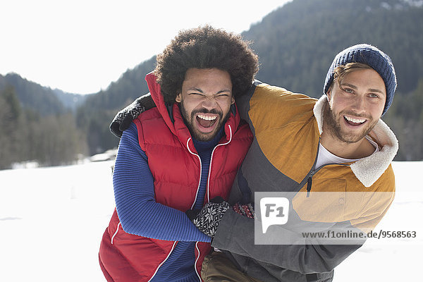 Friends laughing in snow
