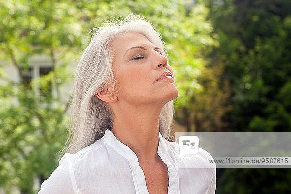 Portrait of mature woman enjoying fresh air