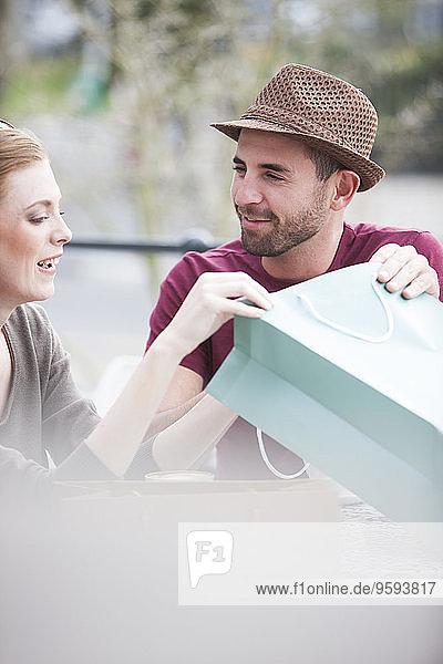 Couple on shopping tour having a break