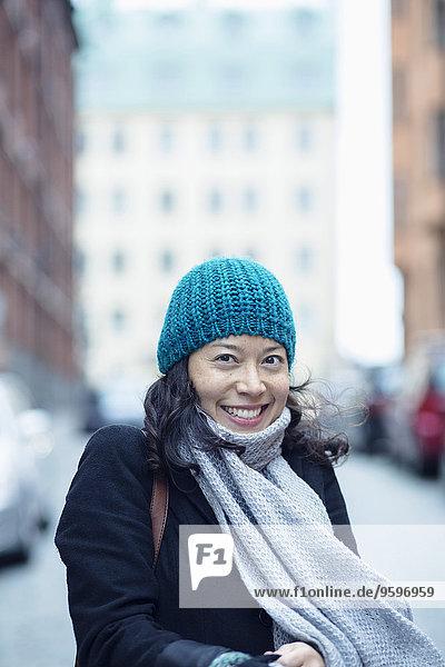 Portrait of happy woman in city street