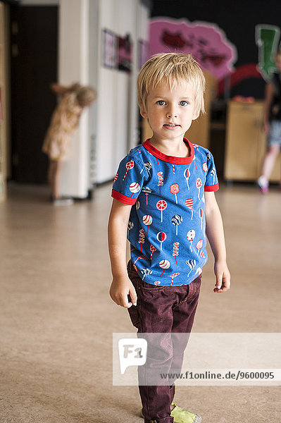 Portrait of cute boy in casuals at primary school