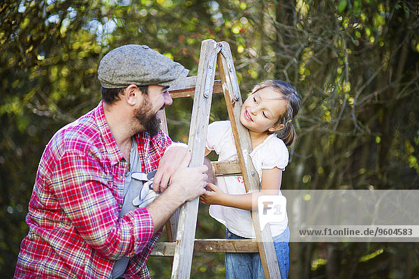 Portrait of father and daughter outdoors  Munich  Bavaria  Germany