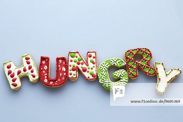 hungrig über Hintergrund Weihnachten blau Zucker Ansicht Wort Keks