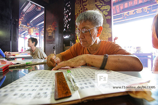 Malaysia  Malacca city  woman at Taoist temple Cheng Hoon Teng