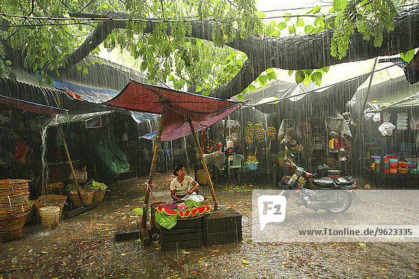 Myanmar  market in monsoon rainfall