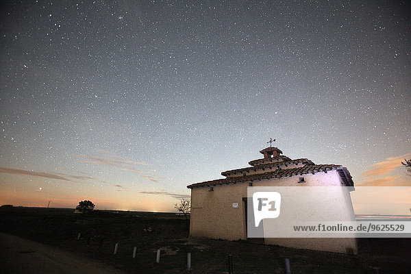 Spain  Province of Zamora  building at a crop field at night under starry sky