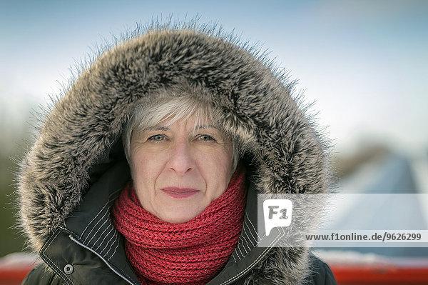Portrait of senior woman in winter  hood with fur