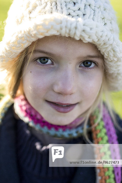 Portrait of girl wearing wool cap and scarf
