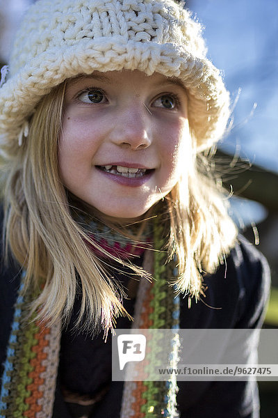 Portrait of girl wearing wool cap