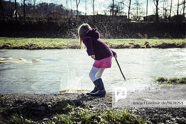 Little girl splashing with water