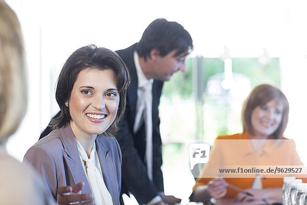 Smiling woman in a business meeting