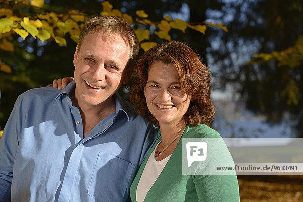 Portrait of couple in autumn  smiling