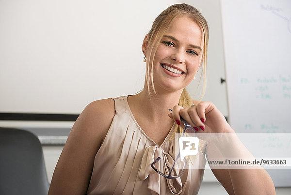 Competent young businesswoman portrait blond
