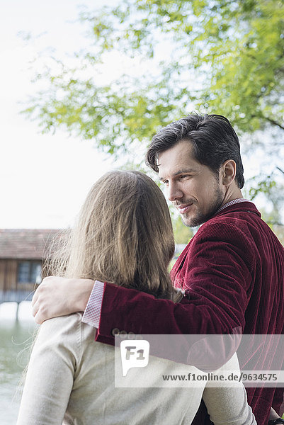 Portrait young loving couple embracing