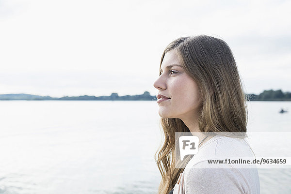 Attractive side profile portrait young woman