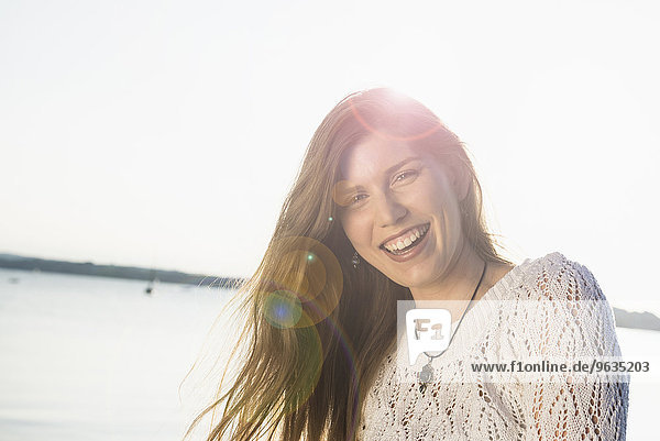Smiling happy portrait pretty young woman sunset