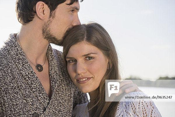 Close up portrait young happy couple embracing