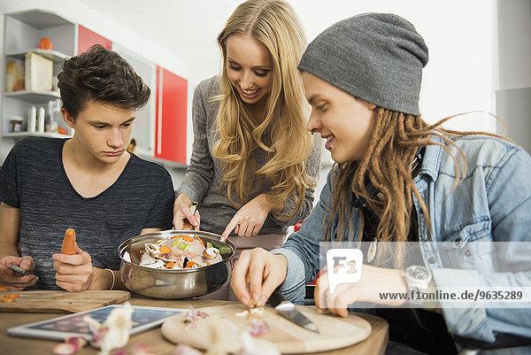 Friends preparing food in the kitchen