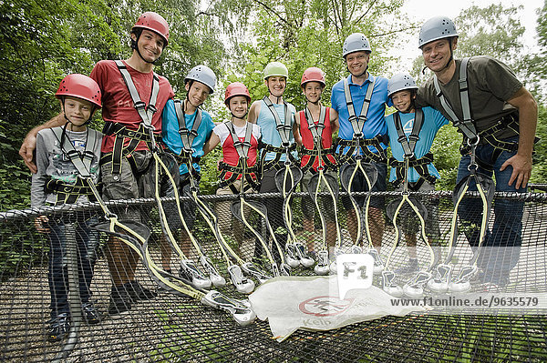 Portrait of climbing group with instructor  smiling