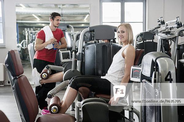 Portrait woman fitness studio man sport fit