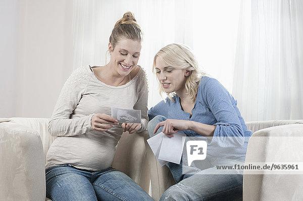 Two girlfriends women looking ultrasonic scan