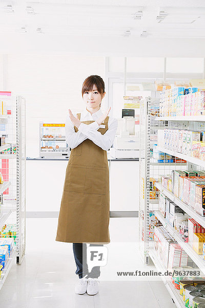 Young Japanese woman working at convenience store
