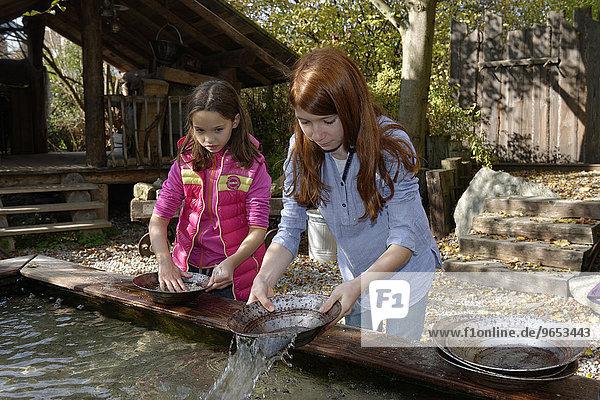 Children panning for gold  gold panning at Drachenschmiede Flederwisch  Furth im Wald  Upper Palatinate  Bavaria  Germany  Europe