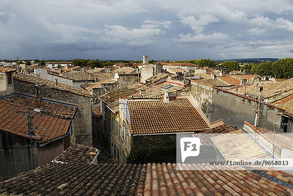 Panoramic view over the red rooftops of Arles  Provence  South of France
