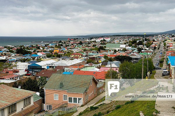 Overview of Punta Arenas on the Strait of Magellan in southern Chile on an overcast day.
