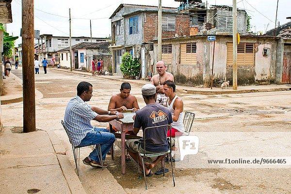 cuba  baracoa  boys playing domino.