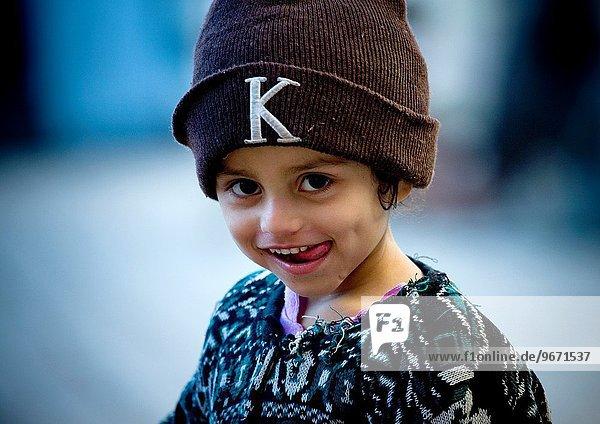 Girl With Toothy Smile Wearing A Woollen Hat In Sanaa  Yemen