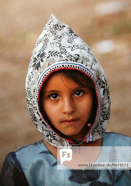 Shahara Girl Wearing A White & Black Floral Designed Hat  Yemen