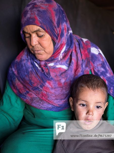 Portrait of boy with mother  Erg Chebbi  Morocco.