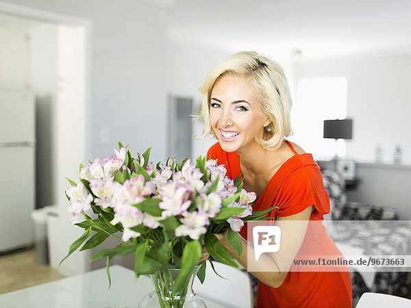 Woman in living room with bunch of flowers