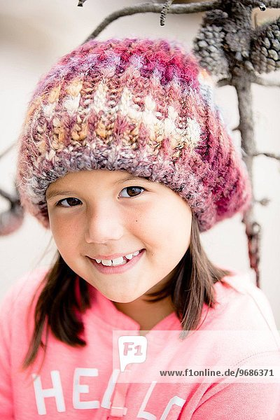 Portrait of smiling girl (6-7) wearing knit hat