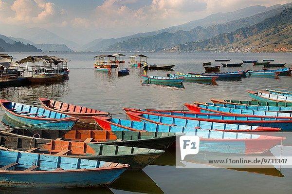 Boats on Begnas Lake Pokhara Nepal.