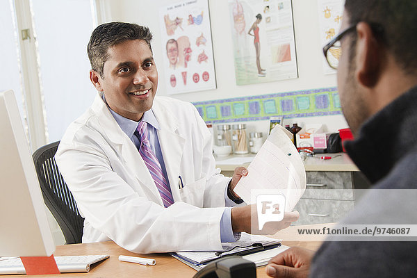 Doctor talking to patient in doctor's office