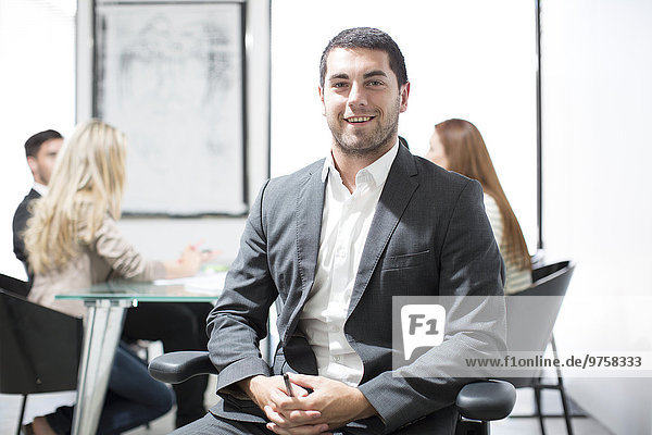 Portrait of confident businessman in boardroom