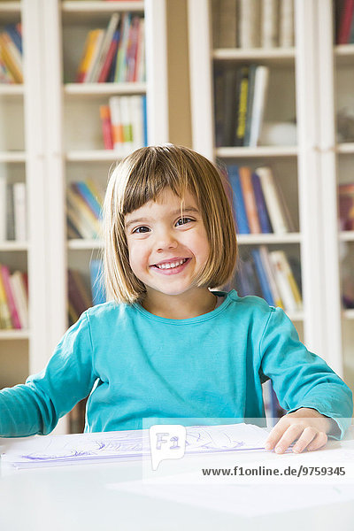Portrait of smiling little girl with drawing