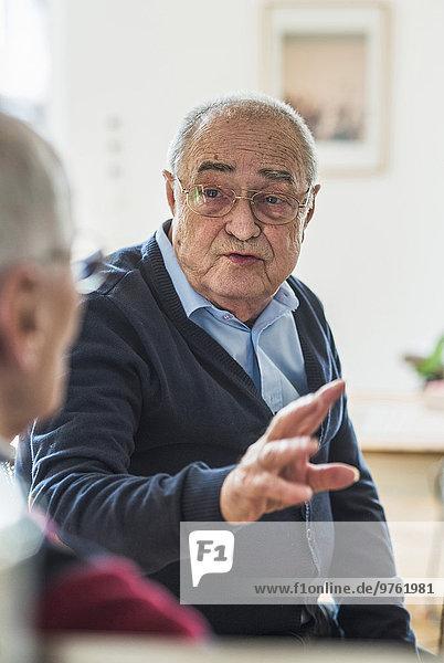Two senior friends talking