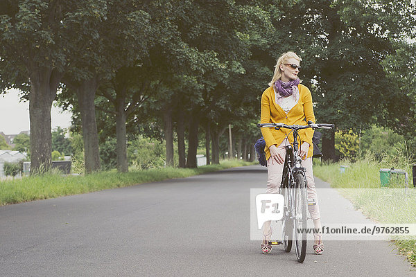 Germany  Duesseldorf  woman on bicycle