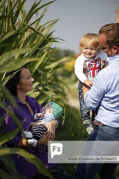 Happy family at cornfield