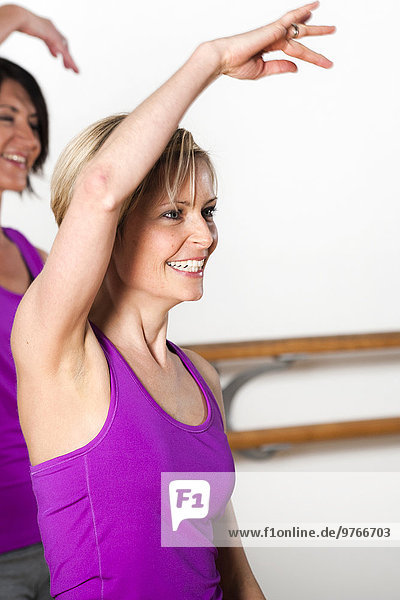 Smiling woman practicing in a health club