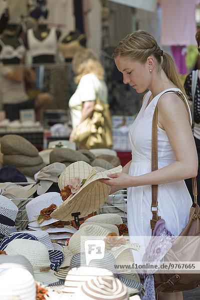 Woman at a hat shop