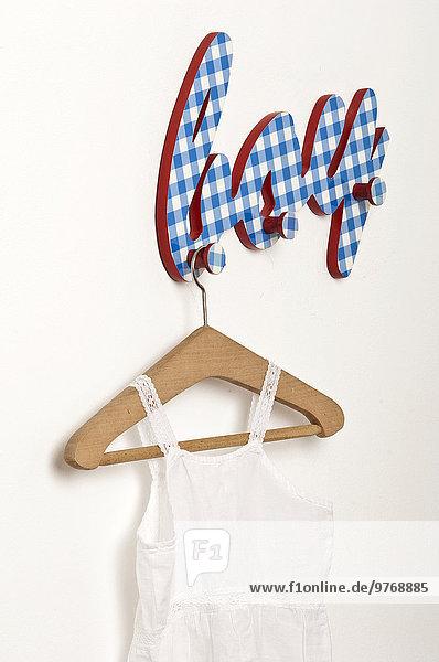 Children's dress on coat hanger