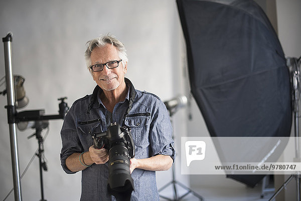 Portrait of photographer in his studio