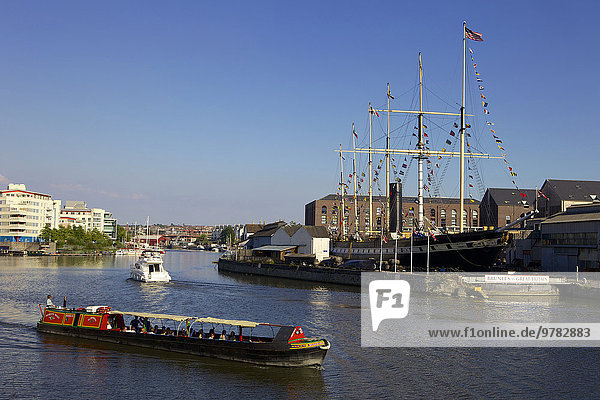 Boats passing the SS Great Britain in Bristol Floating Harbour  Bristol  England  United Kingdom  Europe