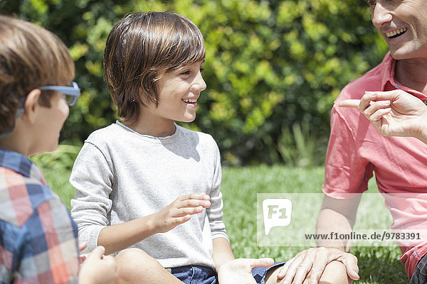 Young boys enjoying outdoor recreation with parents