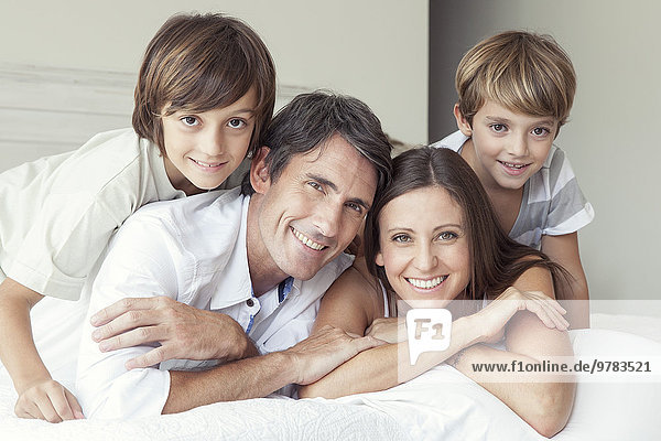 Family lying on bed  portrait