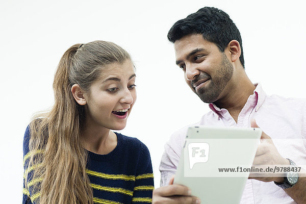 Low angle view of couple using digital tablet